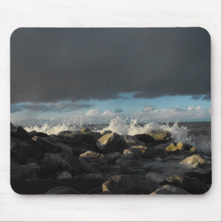 waves hit some rocks mousemat