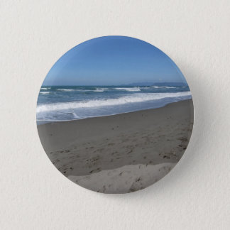 Waves of the sea on the sand beach 6 cm round badge