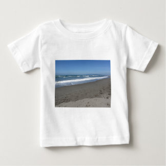 Waves of the sea on the sand beach baby T-Shirt