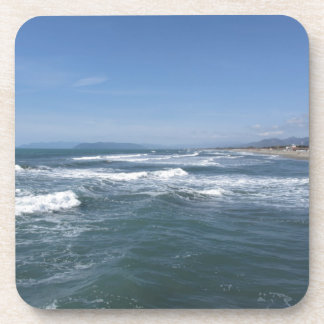 Waves of the sea on the sand beach beverage coaster