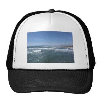Waves of the sea on the sand beach cap