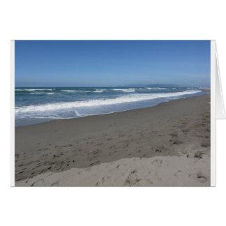 Waves of the sea on the sand beach card