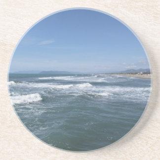 Waves of the sea on the sand beach coaster