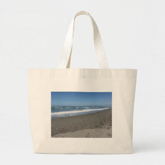 Waves of the sea on the sand beach large tote bag