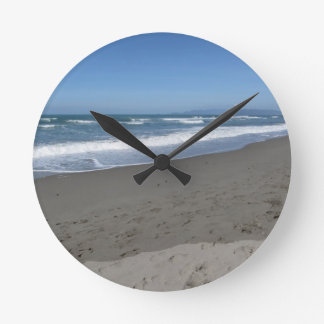 Waves of the sea on the sand beach round clock