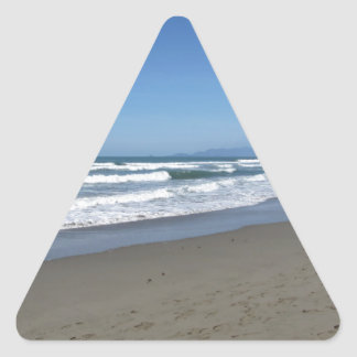Waves of the sea on the sand beach triangle sticker
