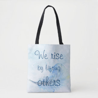 We rise by lifting others watercolor feather tote bag