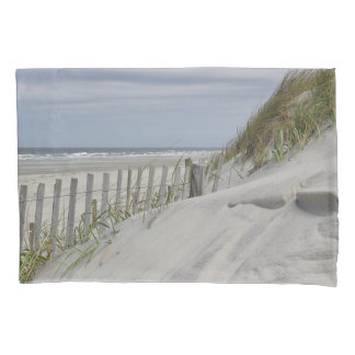 Weathered fence and sand dunes at the beach pillowcase