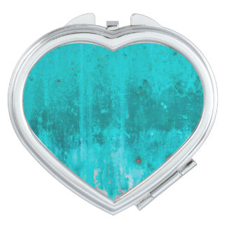 Weathered turquoise concrete wall texture compact mirrors