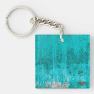 Weathered turquoise concrete wall texture key ring