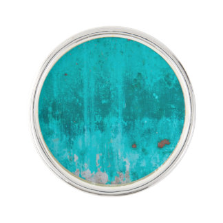 Weathered turquoise concrete wall texture lapel pin