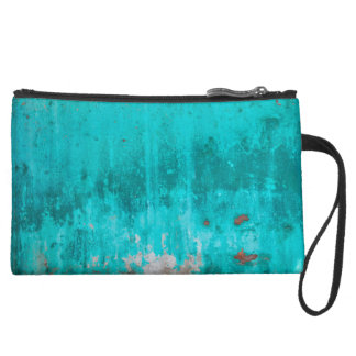 Weathered turquoise concrete wall texture suede wristlet