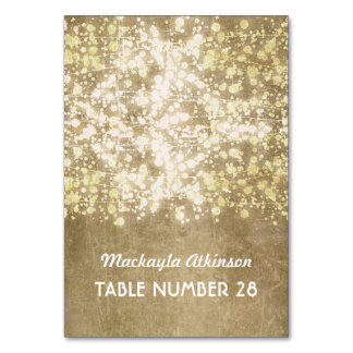wedding escort cards string lights gold glitter table card