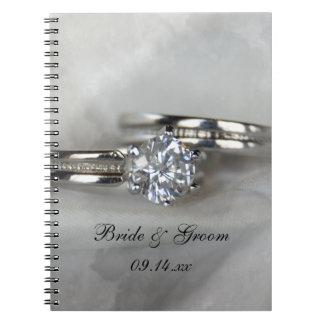 Wedding Rings on Gray Notebook
