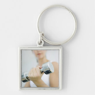 Weightlifting. Woman lifting dumbbells. This Key Chain