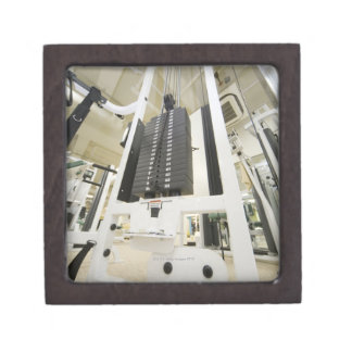 Weights on an exercise machine in gym, low angle premium keepsake box