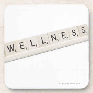 Wellness Spelled On A Word Board Game. Beverage Coaster