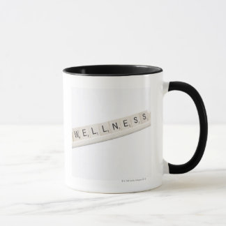 Wellness Spelled On A Word Board Game. Mug