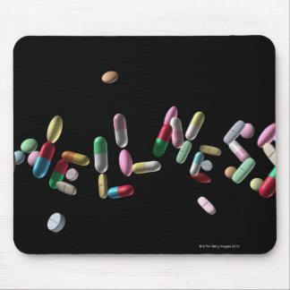 'WELLNESS' written with pills Mouse Pad
