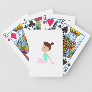 Wellness  yoga woman on white bicycle playing cards