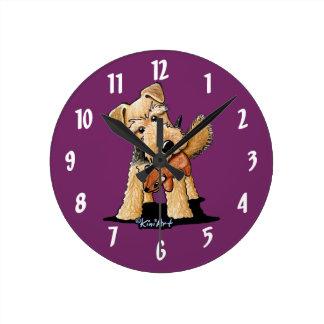 Welsh Terrier With Toy Squirrel Round Clocks