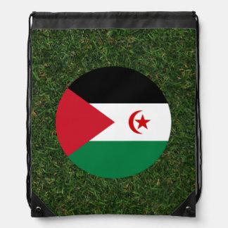 Western Sahara Flag on Grass Drawstring Backpacks