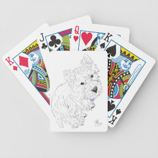 Westie siting at my feet bicycle playing cards