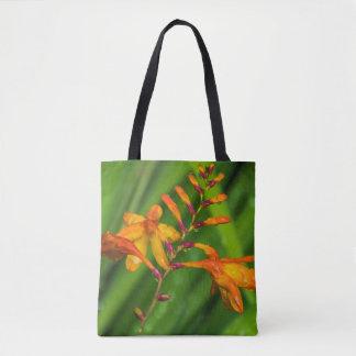 Wet orange flower all-over-print tote bag