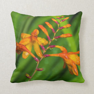 Wet orange flower throw cushion