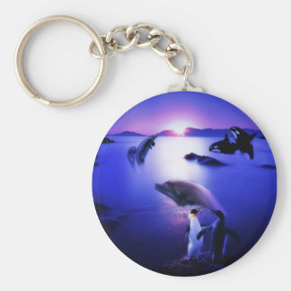 Whales dolphins penguins ocean sunset key ring