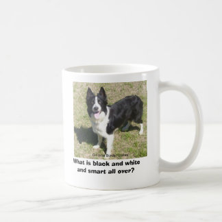 What is black and white and smart all over coffee mug