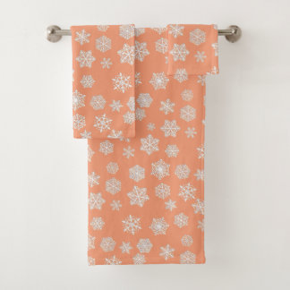 White 3-d snowflakes on a peach background bath towel set