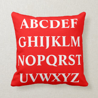 WHITE ALPHABET on bright red pillow