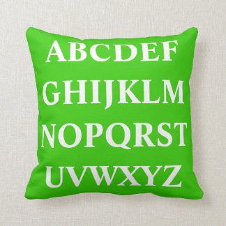 WHITE ALPHABET on  green plain pillow
