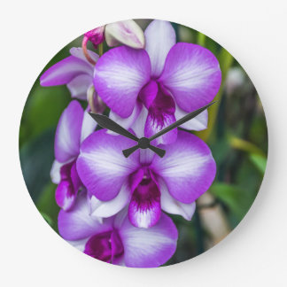 White and purple orchids wall clock