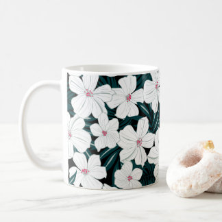 White and red flowers on green leaves coffee mug