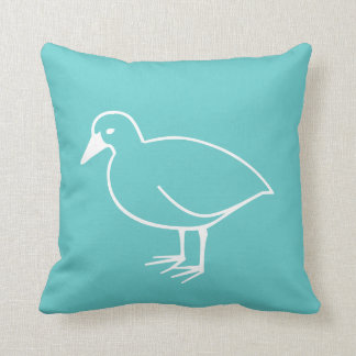 white bird on teal blue pillow