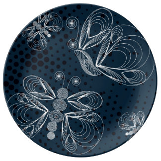 White butterflies on navy blue grunge background porcelain plate