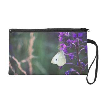 White Butterfly on Purple Wildflower Wristlet Purses