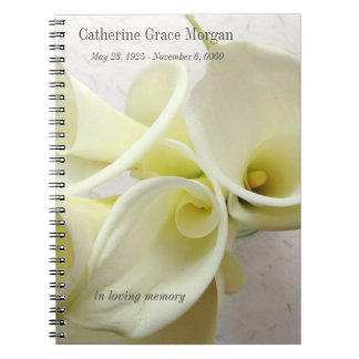 White calla lilies from above memorial notebooks