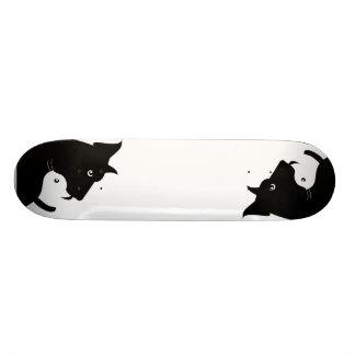 White cat, black dog skateboard