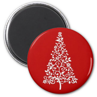 White Christmas tree on red round magnet