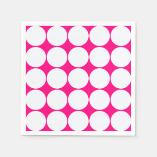 white circles in bright pink paper napkins