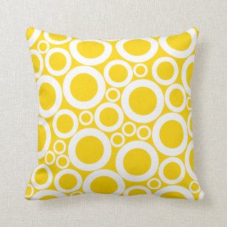 white circles on yellow throw pillow