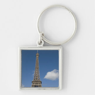 white clouds against blue sky behind the Eiffel Silver-Colored Square Key Ring