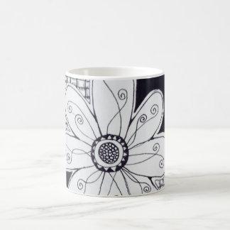 White coffee mug with flower drawing.