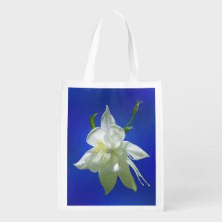 White Columbine on Blue Reusable Grocery Bag