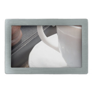 White cup of hot cocoa and a chocolate biscuit rectangular belt buckles
