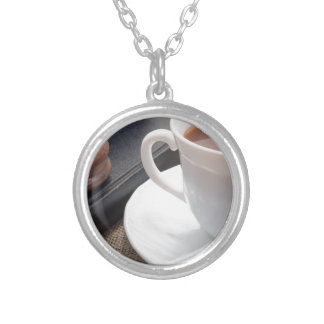 White cup of hot cocoa and a chocolate biscuit silver plated necklace