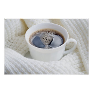 White cup of hot coffee surrounded by a white wool poster